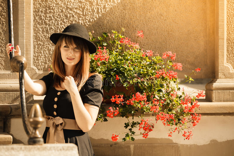 Retro style fashion woman in old town royalty free stock photo