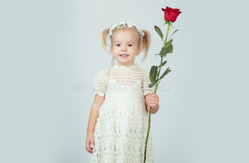 Retro style. happy birthday. wedding. little girl in vintage dress. Beauty. small kid with red rose. happy childhood. Love present. childrens day. valentines stock photography