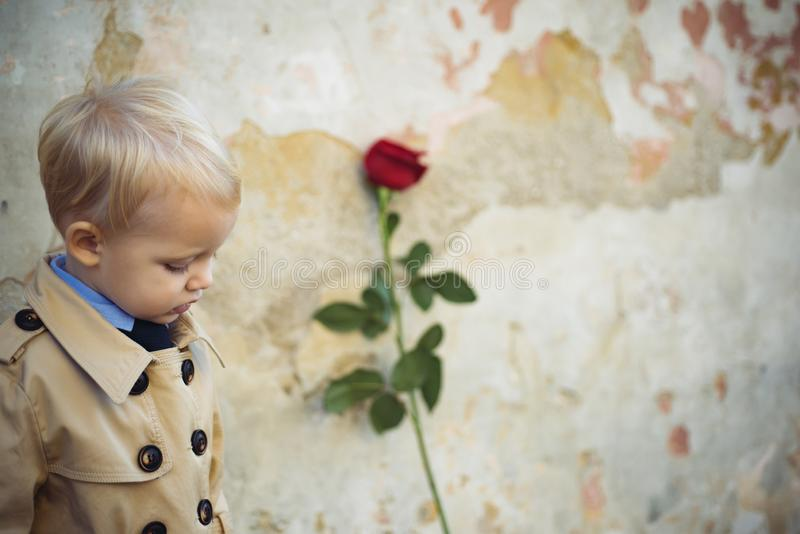 Retro style. happy birthday. wedding. valentines day. romantic date. little boy in vintage coat. Beauty. small kid with. Red rose. happy childhood. love present royalty free stock images