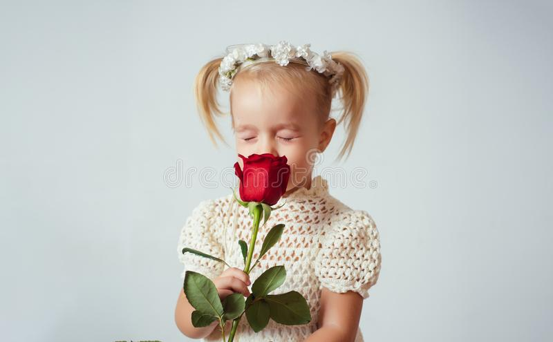 Retro style. happy birthday. wedding. valentines day. romantic date. little girl in vintage dress. Beauty. small kid. With red rose. happy childhood. love stock images