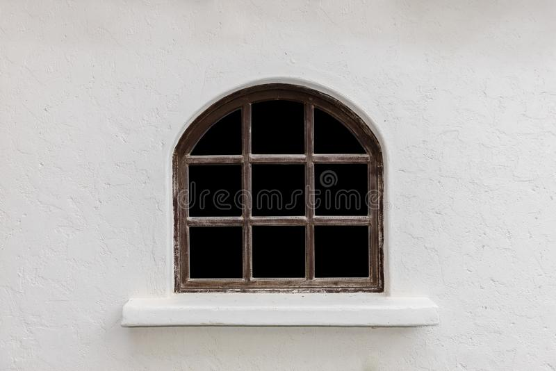 Retro style house with antique glass windows on white plaster walls. Background of Retro style house with antique glass windows on white plaster walls stock image
