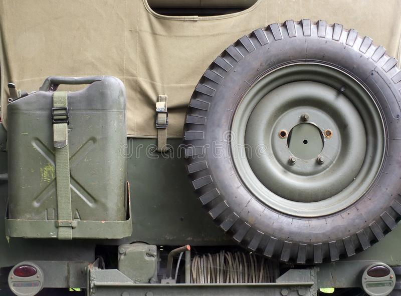 Retro style image of the rear of an old United States World War II Military Jeep Close Up with details of military equipment stock image