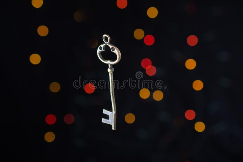 Retro style key on a bokeh light. Background stock image