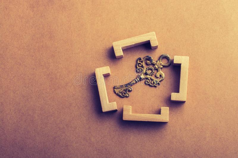 Retro style key in wooden brackets royalty free stock photography