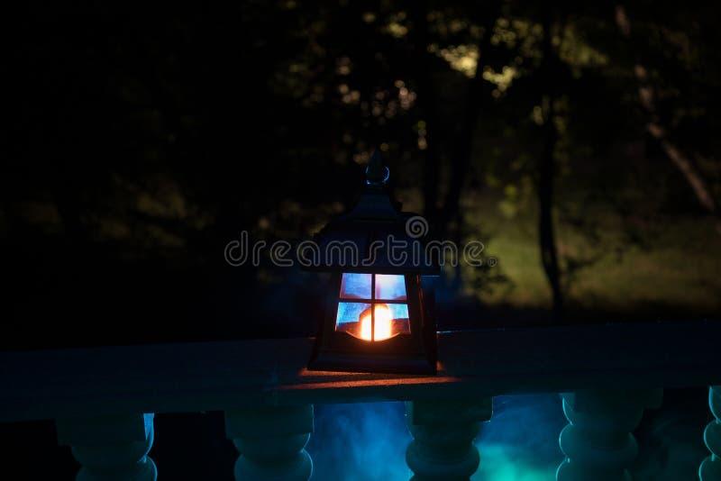 Retro style lantern at night. Beautiful colorful illuminated lamp at the balcony in the garden stock photos