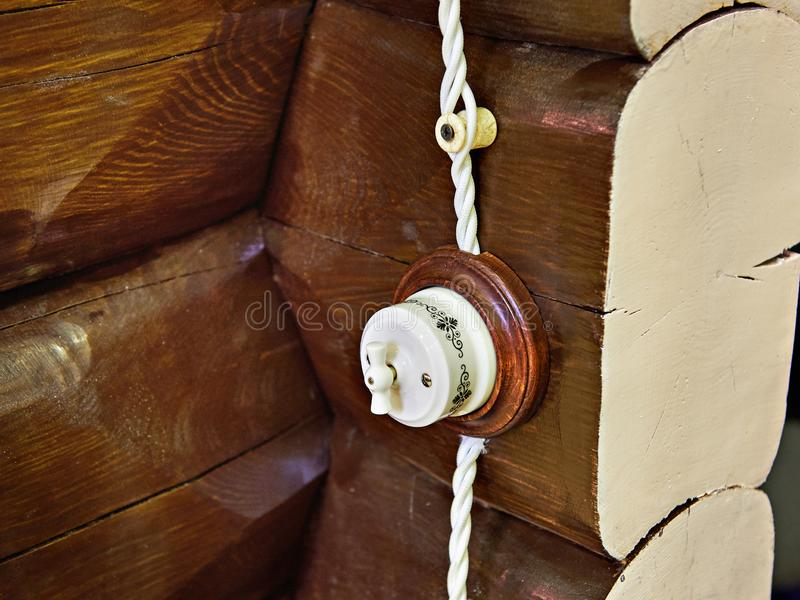 Retro light switch on wall of logs stock photos