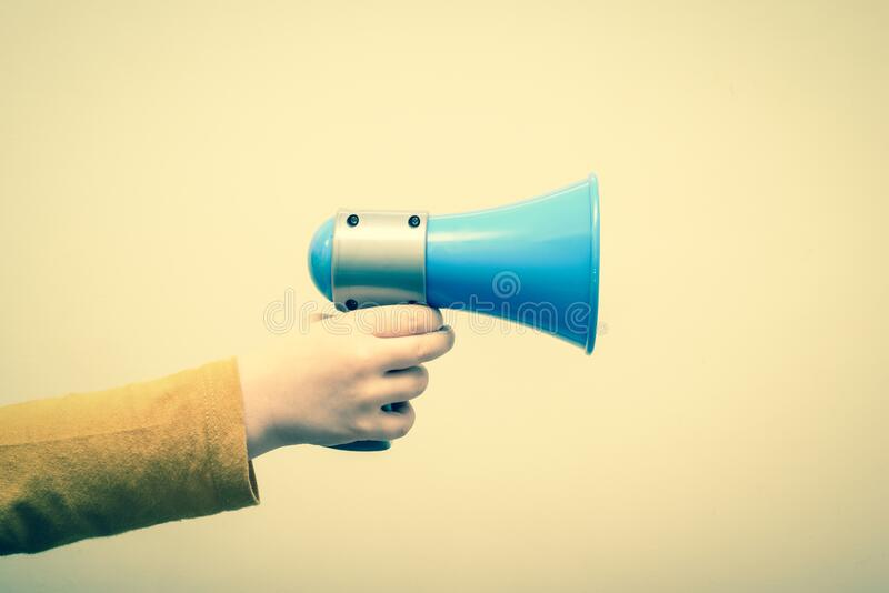 Retro style megaphone announcement background with vintage border and hold holding speaker stock photo