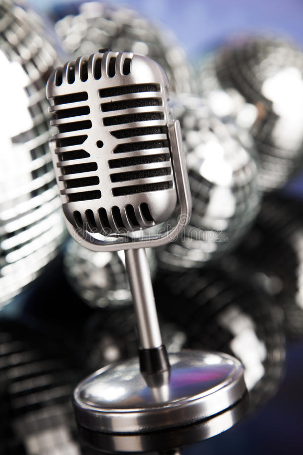 Retro style microphone on sound waves and Disco Balls. Sound waves, Microphone with disco balls stock images