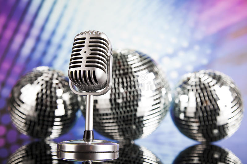Retro style microphone on sound waves and Disco Balls. Sound waves, Microphone with disco balls stock image