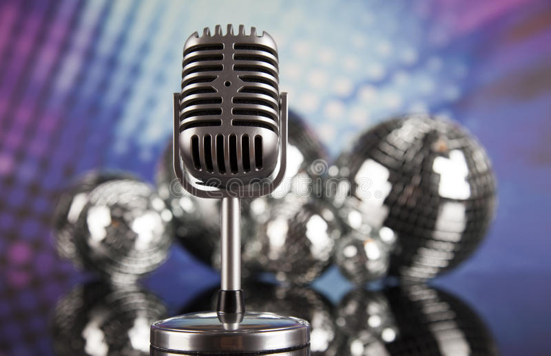 Retro style microphone on sound waves and Disco Balls. Sound waves, Microphone with disco balls stock photos