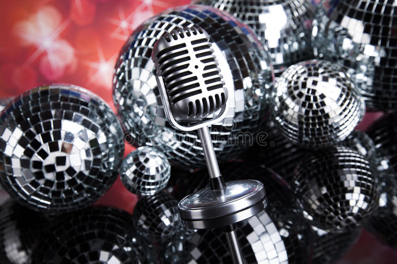 Retro style microphone on sound waves and Disco Balls. Sound waves, Microphone with disco balls stock photo
