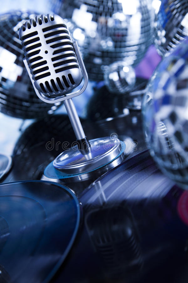 Retro style microphone on sound waves and Disco Balls. Sound waves, Microphone with disco balls royalty free stock images