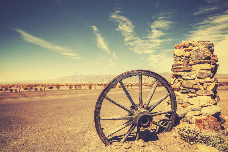 Retro style old cartwheel, wild west concept, USA. Retro style old cartwheel, wild west concept, Death Valley, USA stock images
