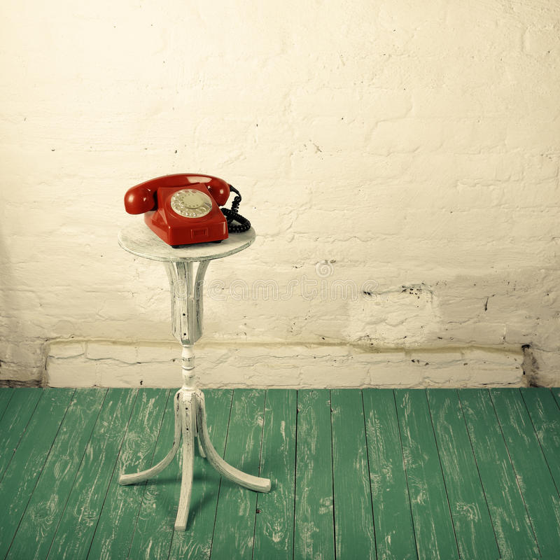 Retro style - Red vintage phone old flowers stand stock photography
