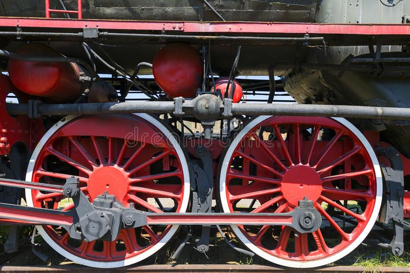 Retro style steam locomotive with red wheels royalty free stock image