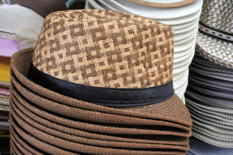 Retro style unisex straw hats on display in the market. Travel holiday vacation accessories background. Copy space stock photo