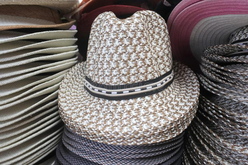 Retro style unisex straw hats on display in the market. Travel holiday vacation accessories background. Copy space stock image