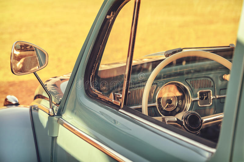Retro styled detail of a classic car. On a summer day during sunset stock photography