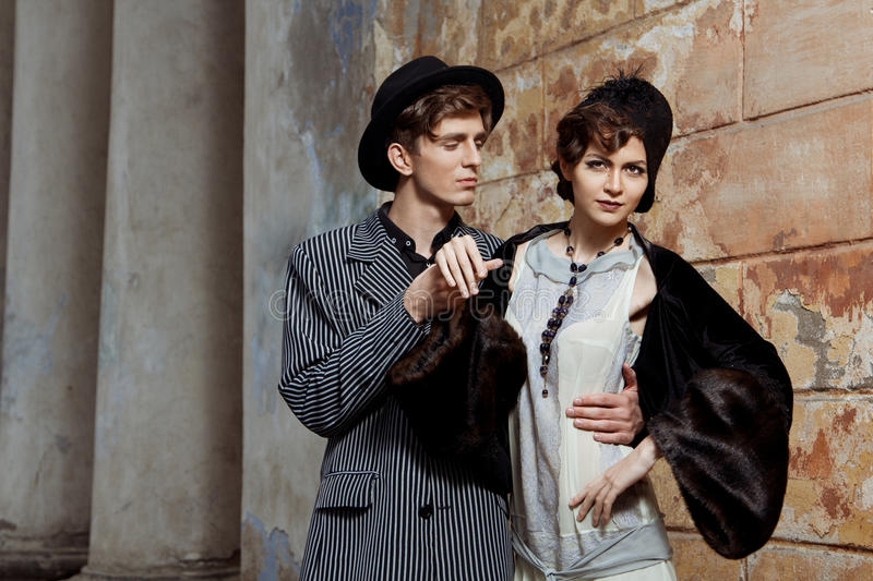 Retro styled fashion portrait of a young couple. Clothing and make-up in 1920s style royalty free stock image