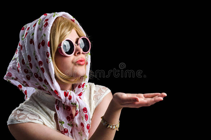 Retro styled girl sending a kiss royalty free stock images