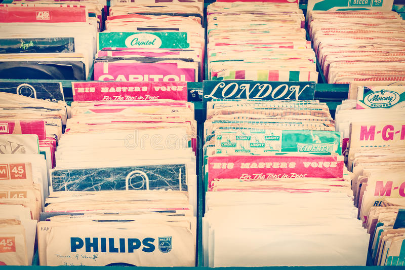 Retro styled image of boxes with vinyl turntable records on a fl stock photography