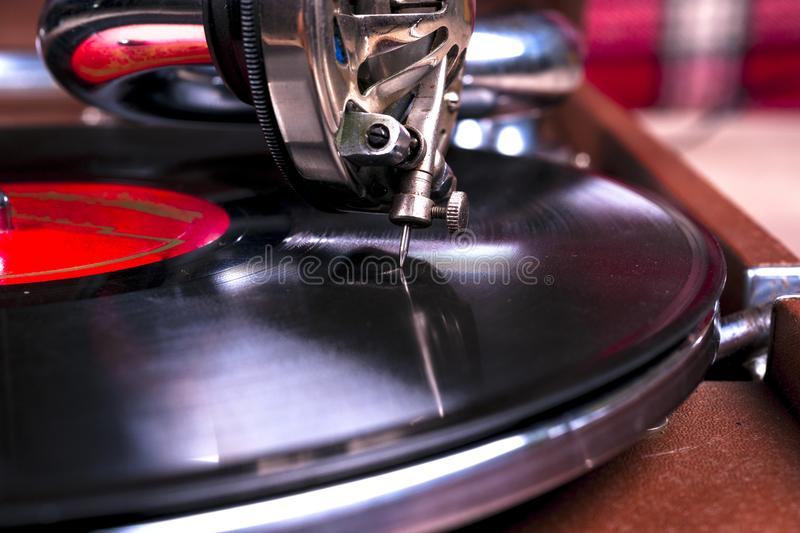 Old gramophone player, closeup. Retro styled image of a collection of old vinyl record lp`s with sleeves. stock images