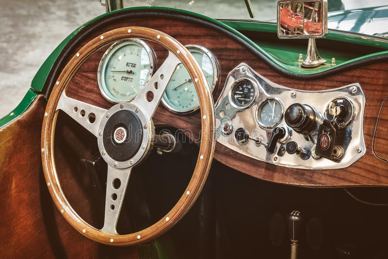 Retro styled image of the dashboard of a 1953 MG TD Roadster. DREMPT, THE NETHERLANDS - FEBRUARY 4, 2014: Retro styled image of the dashboard of a 1953 MG TD royalty free stock images