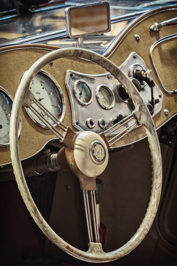 Retro styled image of a 1959 MG A Cab Roadster. DREMPT - NOVEMBER 15: Dashboard of a 1959 MG A Roadster (retro styled image) on November 15, 2013 in Drempt, a stock photo