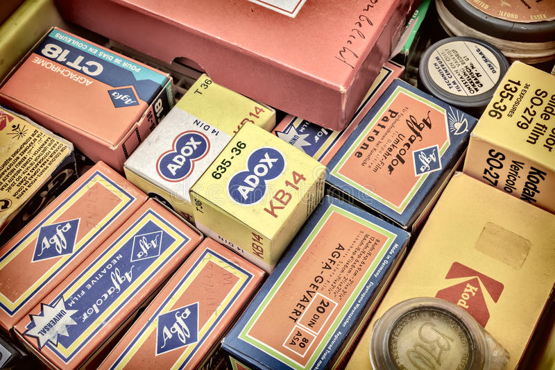 Retro styled image of old color slide film packs on a flee marke stock photography