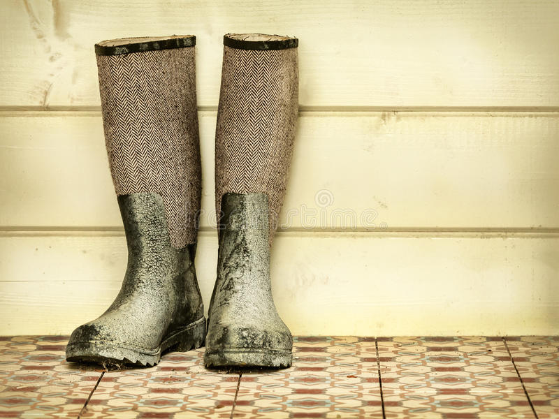 Retro styled image of an old pair of boots stock images