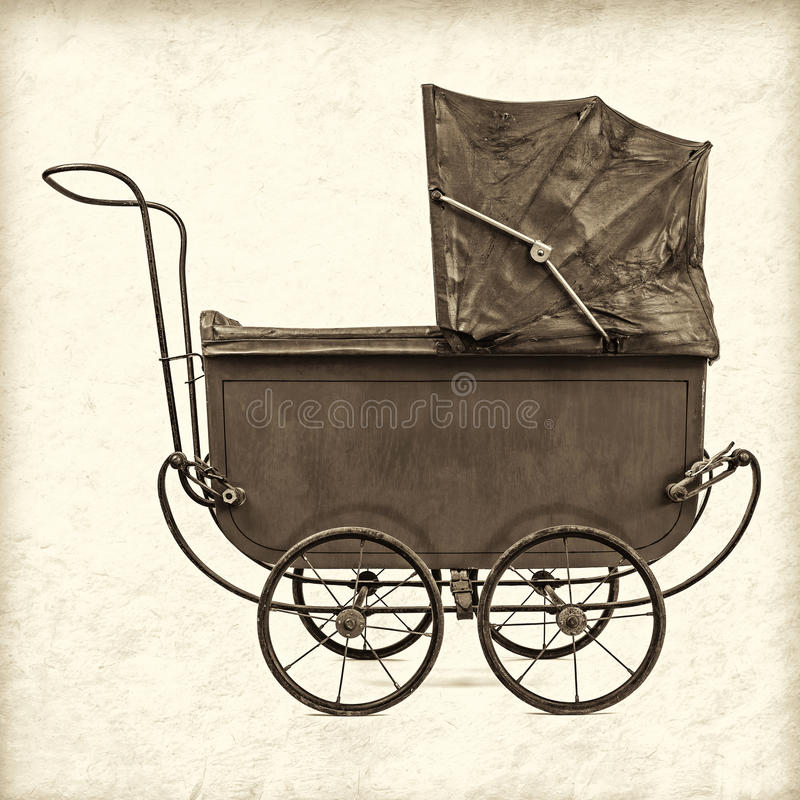 Retro styled image of a vintage baby stroller stock photo