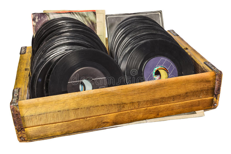 Retro styled image of a wooden box with vinyl lp records. Retro styled image of a wooden box with vinyl turntable records isolated on a white background royalty free stock image