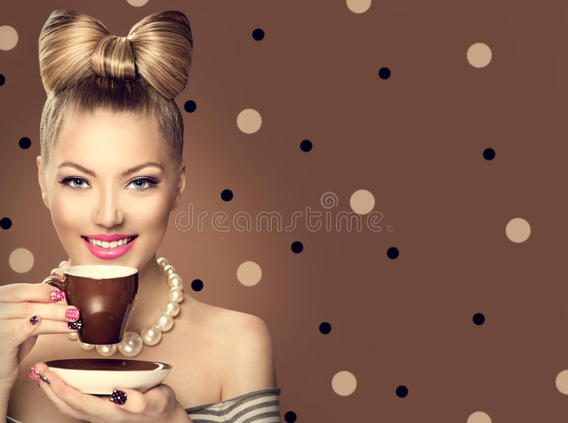 Retro styled model girl drinking coffee. Or tea stock photography