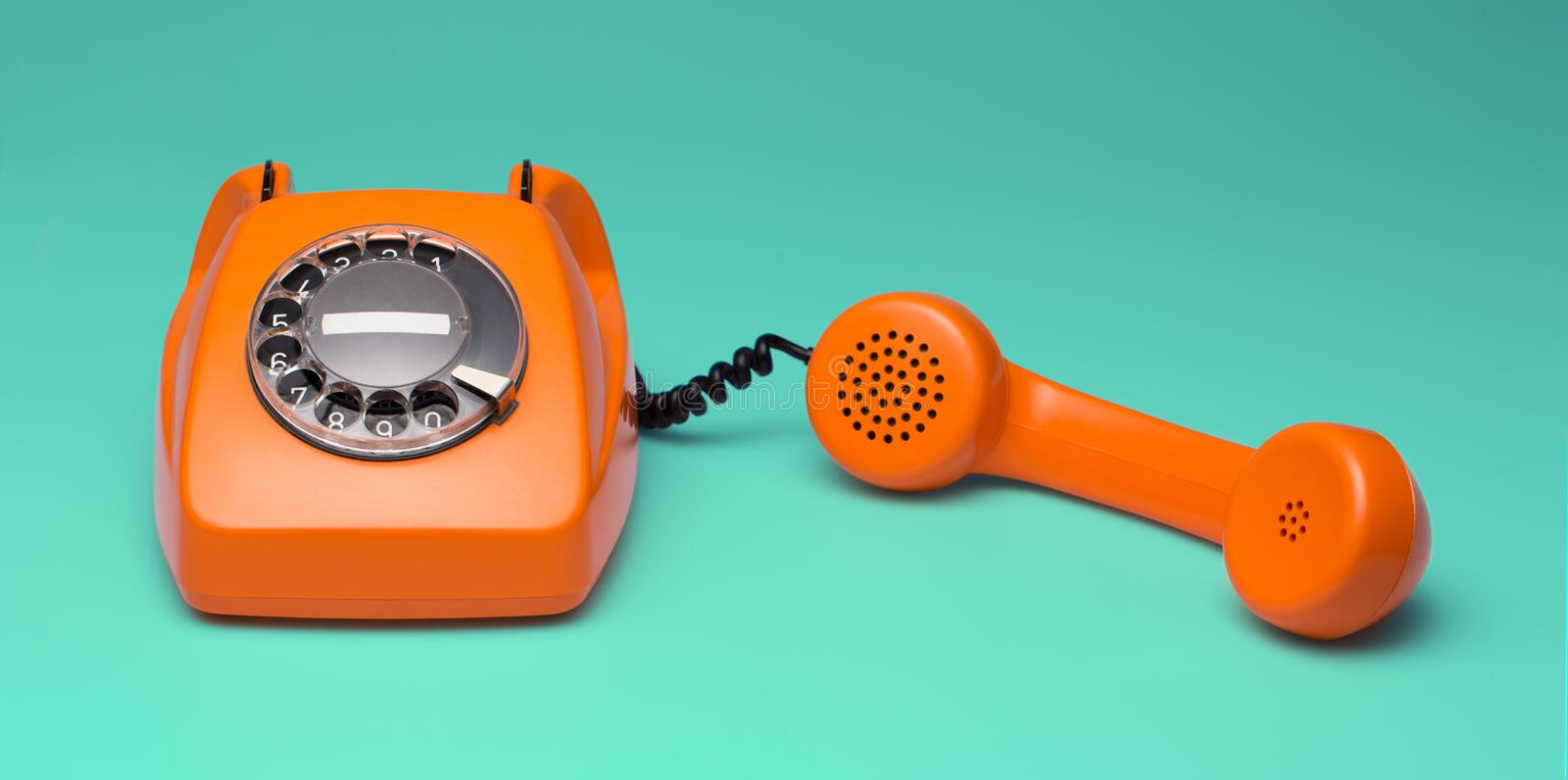 Retro styled phone. Old phone isolated on neutral background stock images