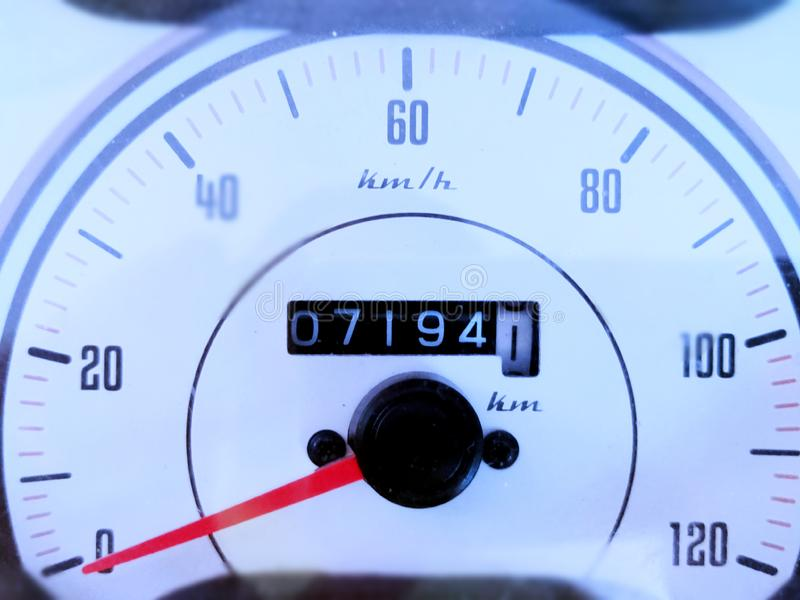 Retro styled simple white colored speedometer with a odometer also there showing concept design and style. A racing automobile. Beautiful, image, scooter royalty free stock images