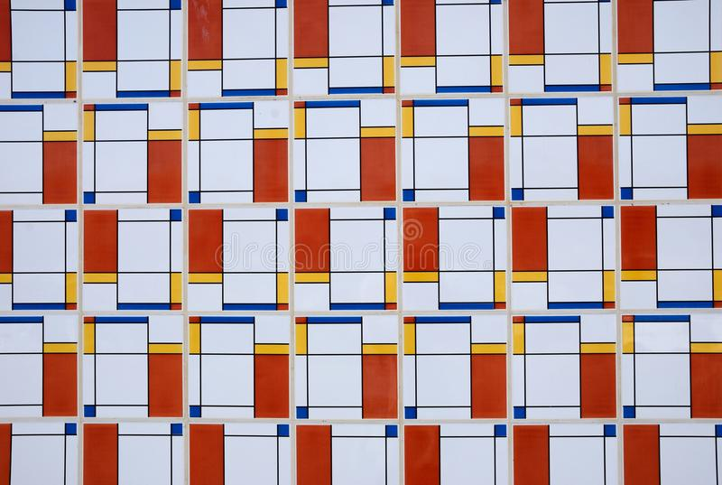 Retro styled wall tiles, Portugal. Retro styled wall tiles in red blue yellow and white, Portugal, Europe royalty free stock images