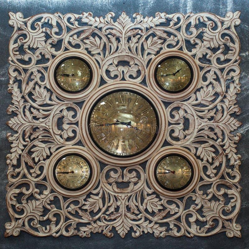 Retro stylish clocks with metalic decorative elements, close-up royalty free stock photos