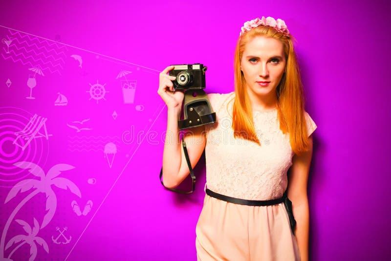 Retro stylish woman with analog camera royalty free stock image