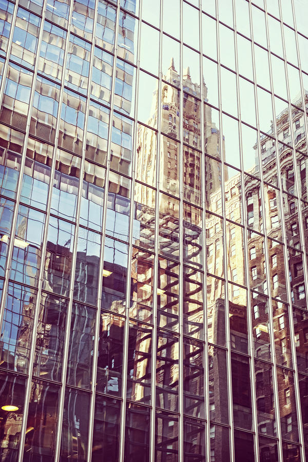 Retro stylized buildings reflection in windows, Manhattan, NYC,. USA royalty free stock images