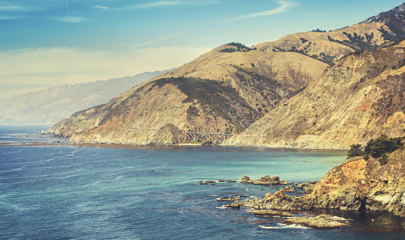 Retro stylized California coastline along Pacific Coast Highway. USA stock photography