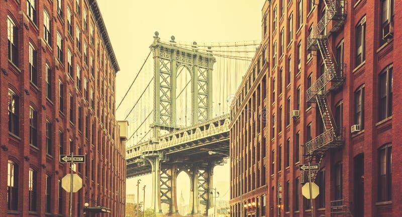 Retro stylized Manhattan Bridge seen from Dumbo, New York.  royalty free stock photo
