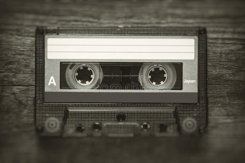 Retro stylized photo of vintage cassette tape with blur and noise effect. stock photo