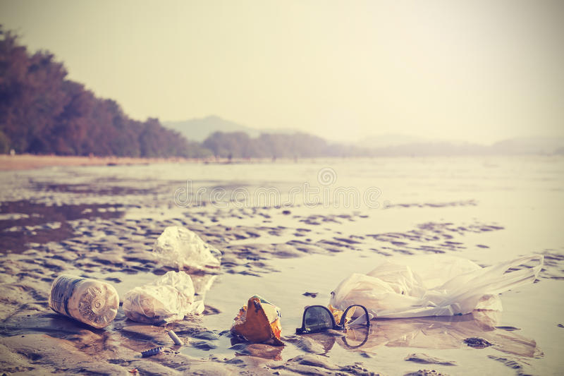 Retro stylized picture of garbage on a beach. stock images