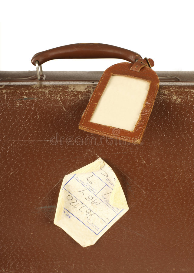 Retro suitcase with travel tag royalty free stock photos