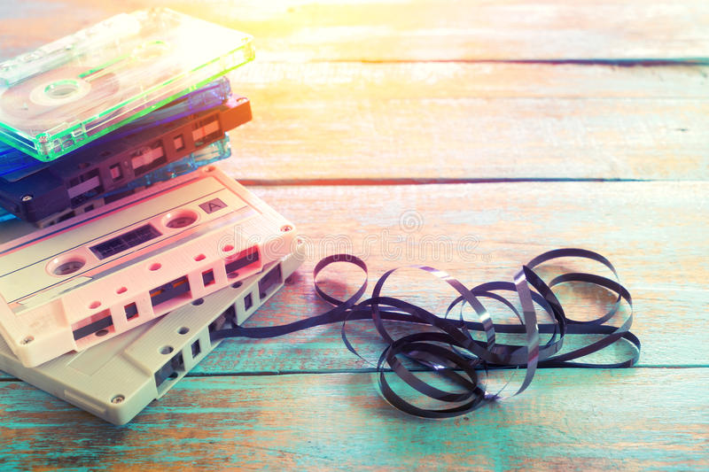 Retro tape cassette over wooden table stock photos