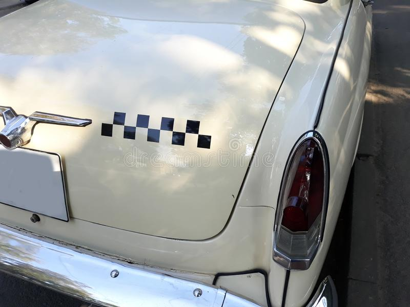Retro taxi ussr volga 1950. With mark sign cubes like chess royalty free stock photo