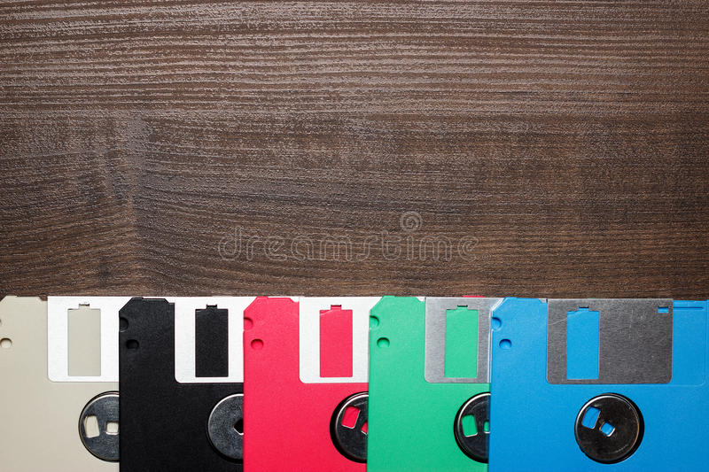 Retro technology concept diskette on wooden stock photo