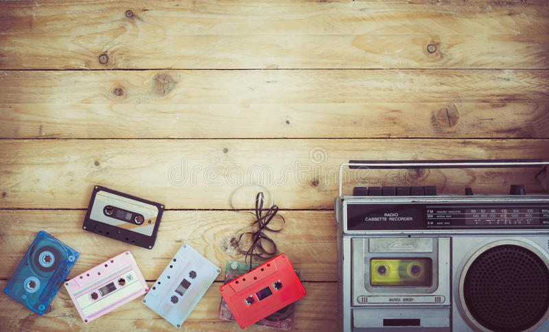 Retro technology of radio cassette recorder music with retro tape cassette on wood table. Top view hero header - retro technology of radio cassette recorder royalty free stock photos