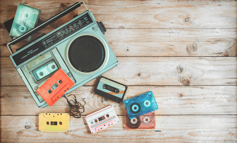 Retro technology of radio cassette recorder music with retro tape cassette on wood table. Top view hero header - retro technology of radio cassette recorder royalty free stock images