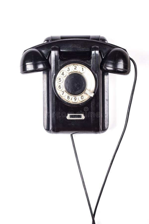 Retro telefon för gammal svart föråldrad tappning som isoleras på vit bakgrund royaltyfria foton